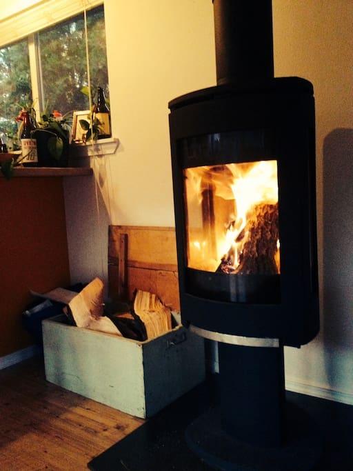Cozy woodfire stove in livingroom.