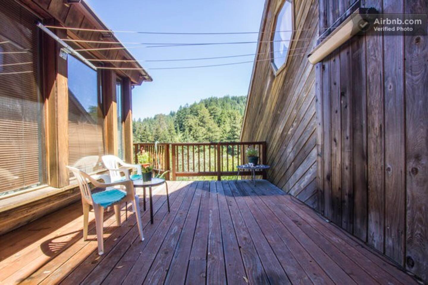 Your private deck overlooking 50 shades of green, organic gardens, redwoods and mountains.