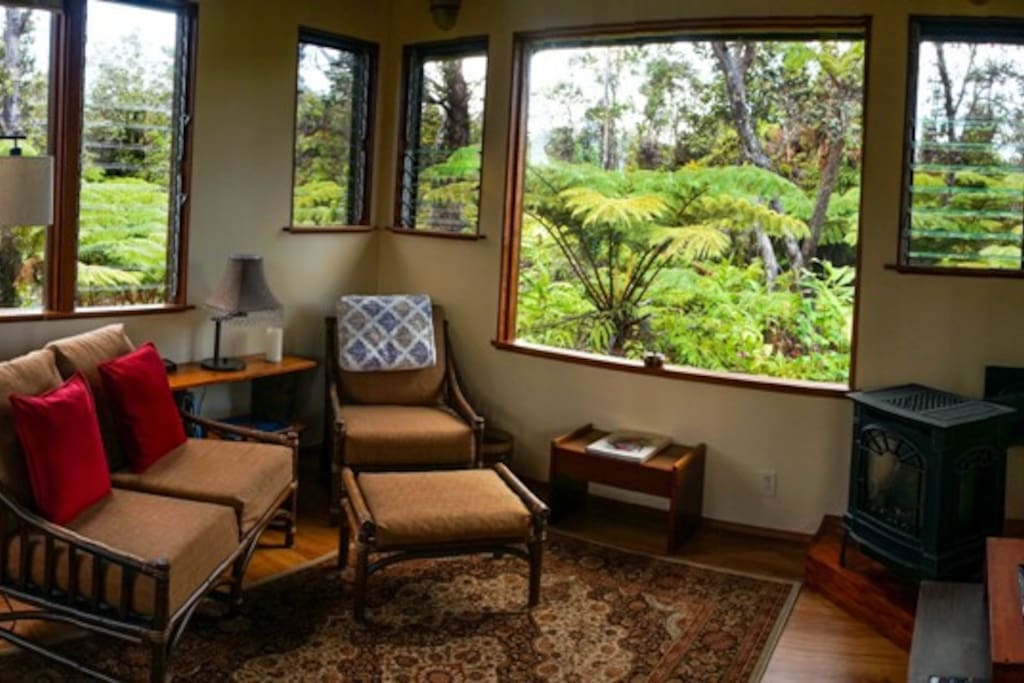Sitting room with  propane fireplace and big picture windows all around.