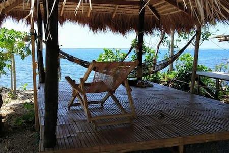 Birdland Beach Club Beach Kubo/Bamboo Hut