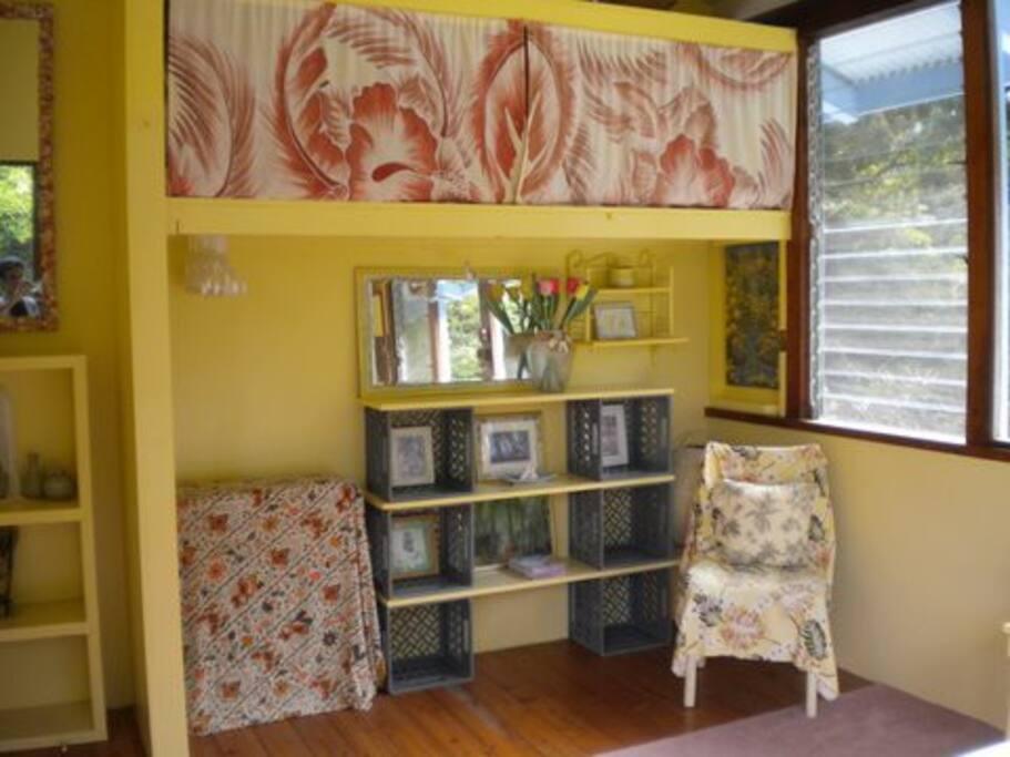 closet/storage area in Cheerful Yellow Bedroom