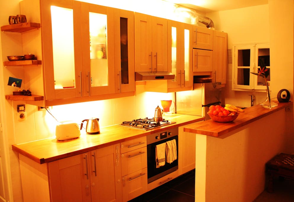 Cabinets with interior lighting and dimmer to create a more intimate mood for your meal.