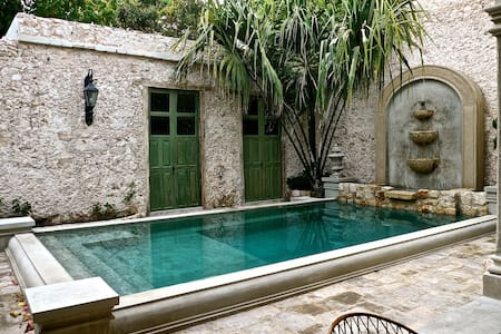 Separate 100 year old casita surrounded by pool and tropical gardens. 1 bedroom and x-large bathroom plus private patio located in the rear of  Historic Maison Azul property. Shared kitchen and pool area separate Casita and Main house.