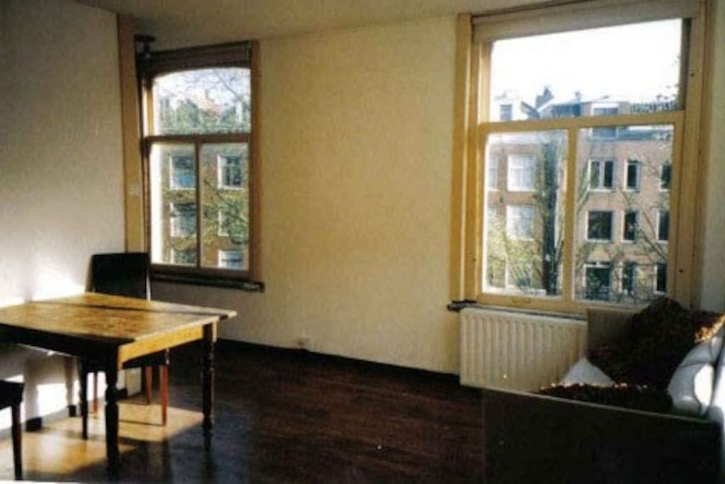 4 great windows overlooking a plaza, south and west light, so lots of light, no neighbours staring into the house,