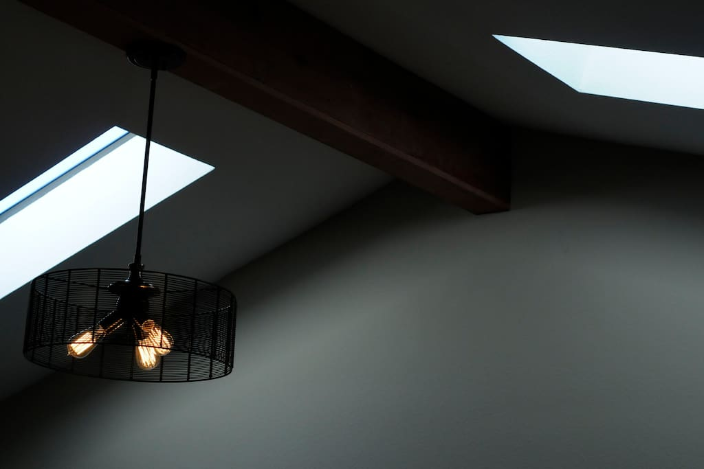 Light fixture and sky lights. There is plenty of light in this space
