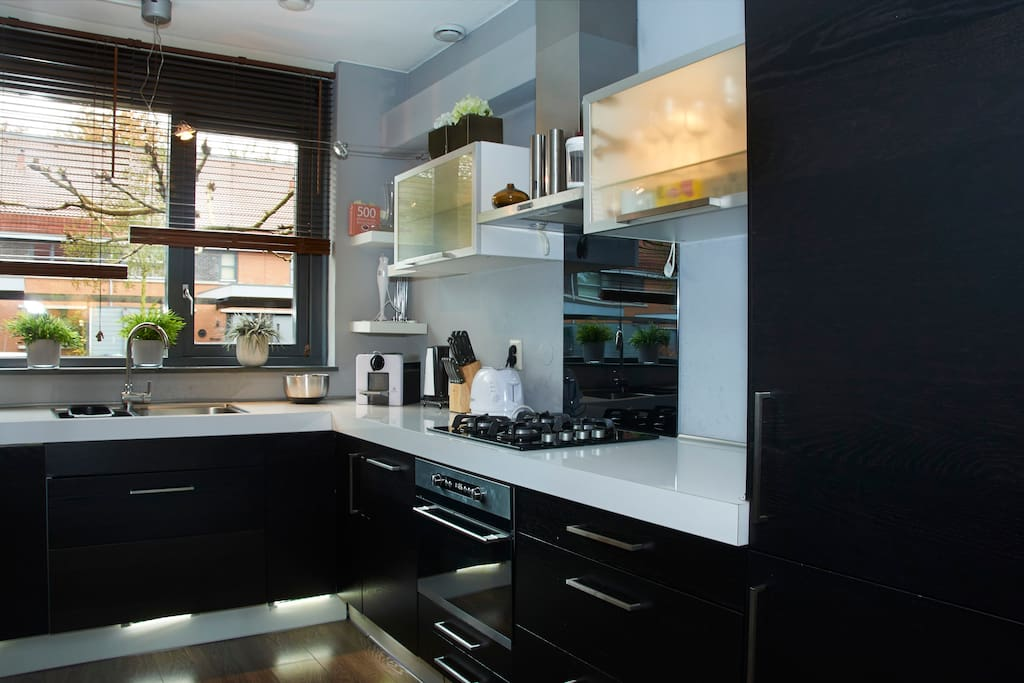 Very complete and nice kitchen.
