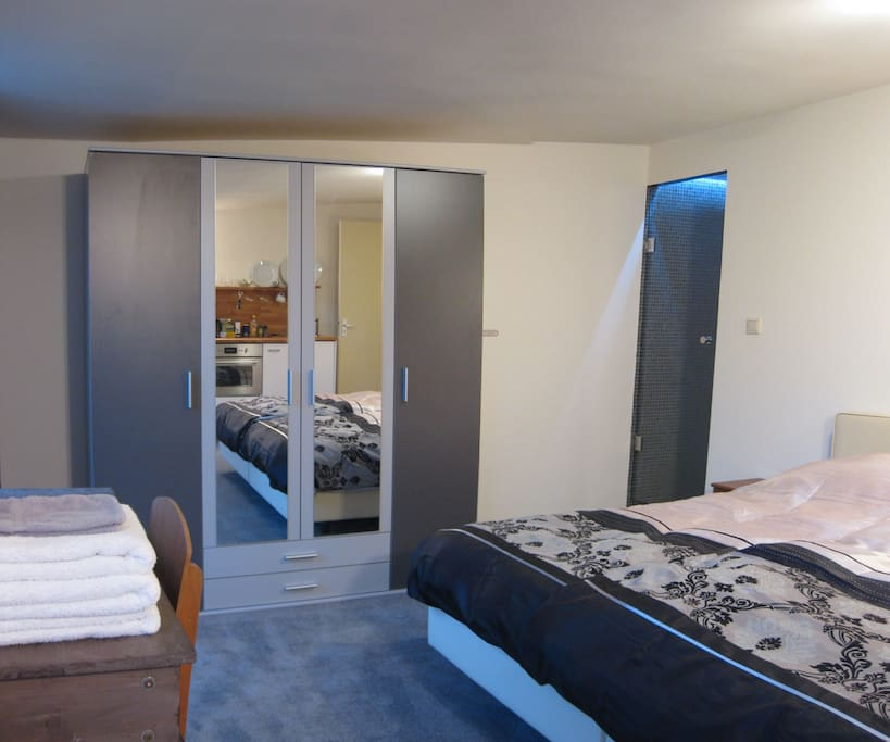Large wardrobe + in the inner corner your private shower. The showerroom measures 0,9x1,3m and is mechanically ventilated