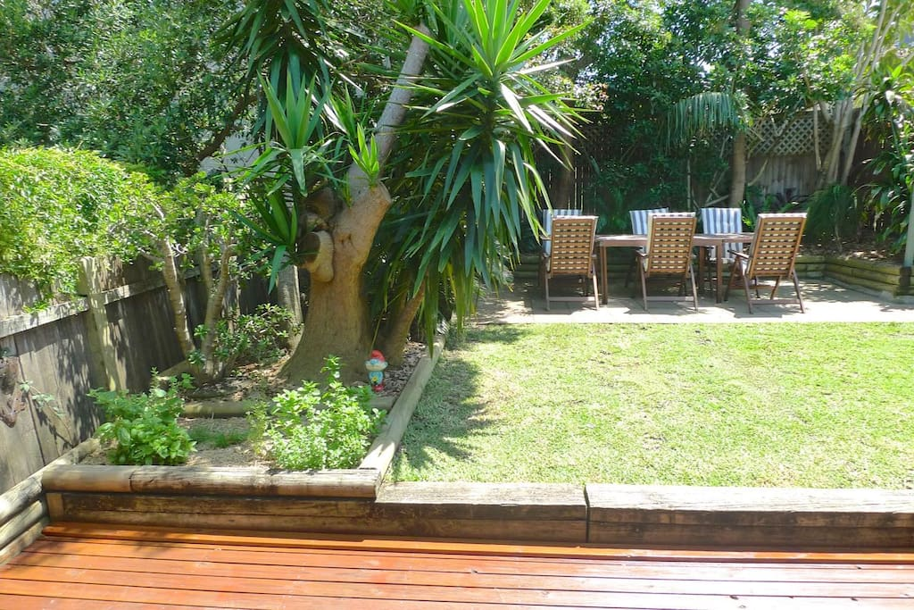 Landscaped rear garden, with deck, grass area and entertaining patio. Herb garden on the left!