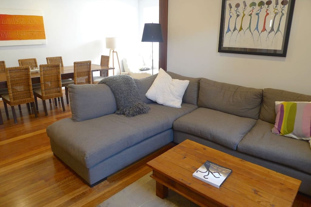 New, comfy couch in open-plan living area