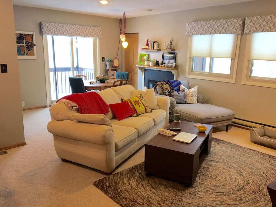 Upstairs living space; fireplace, dining table (seating for up to 8), TV, DVD player, patio.