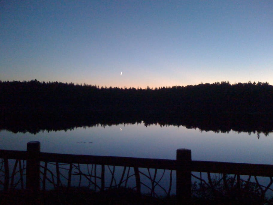 beautiful sunset and moon over the 18 acre lake