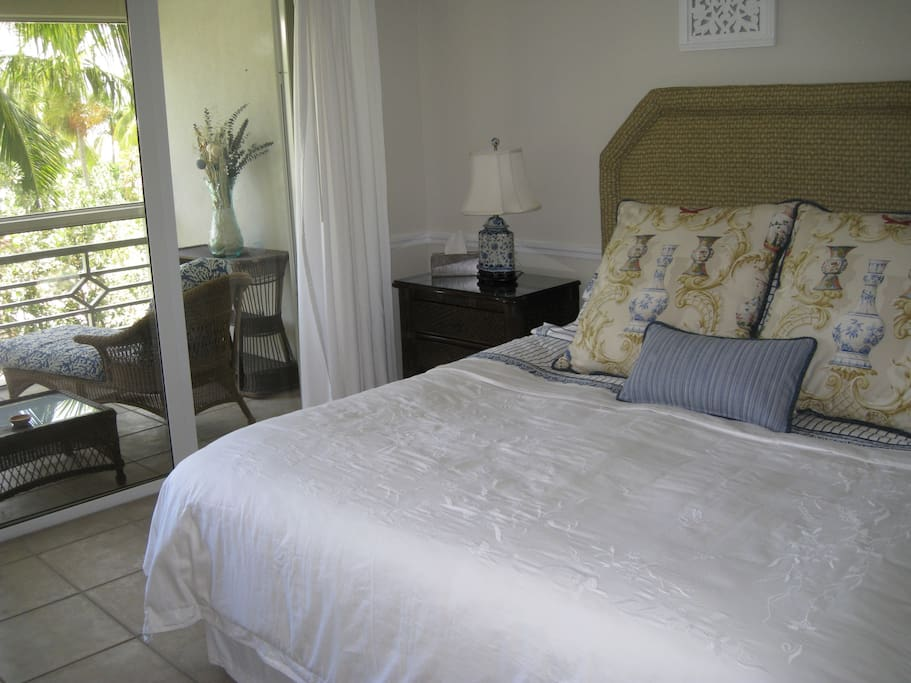 King sized bed with luxury linens