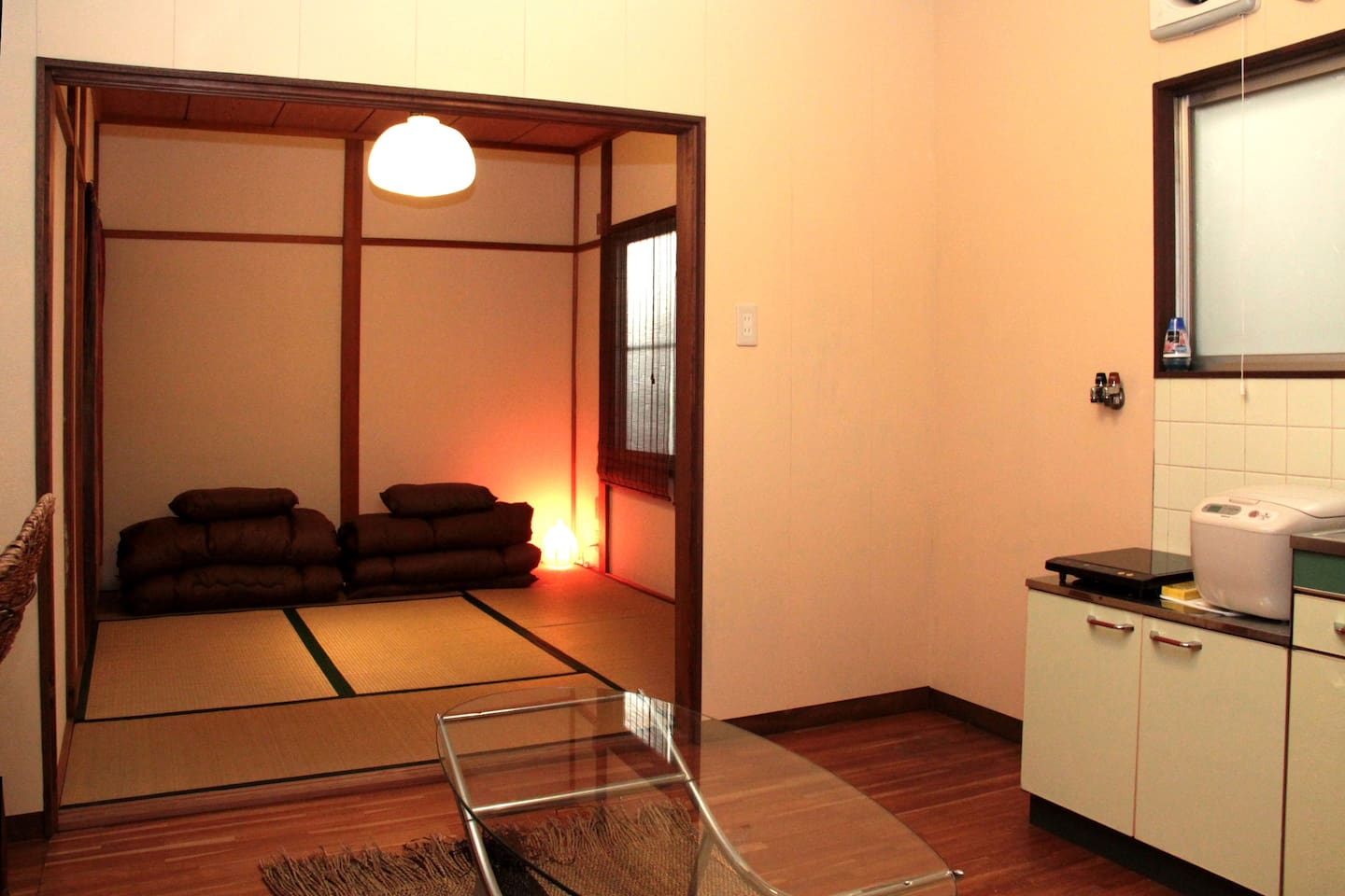 It is a lovely old house, with traditional Japanese style private rooms.Our rooms have futons (Japanese mattress) and tatami mats. I have 2 types of rooms. The size of the room is the almost same. I provide it with a choice of the room which is most suitable for you.