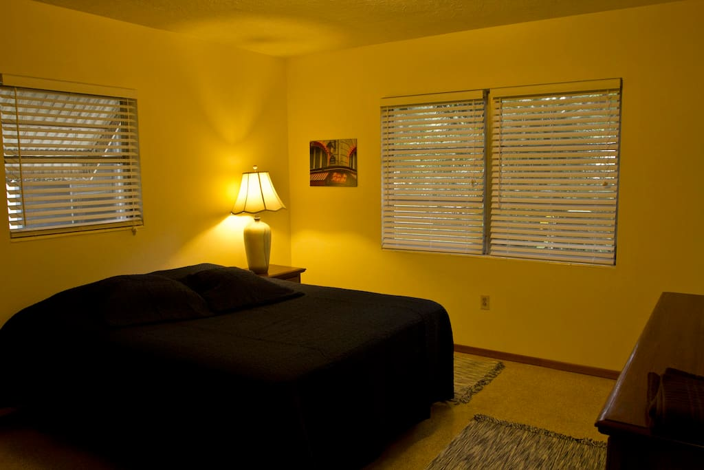 Main bedroom sleeps two in queen bed. Full dresser with mirrors and cedar closet.