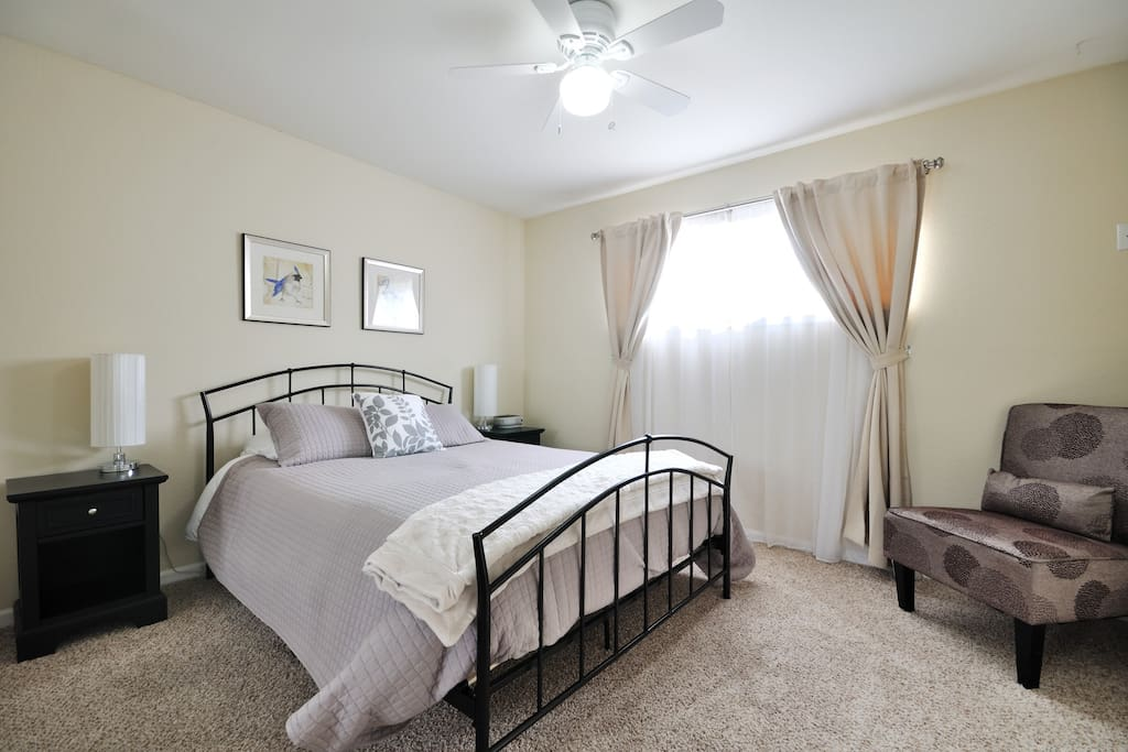 Full-length mirrors in this bedroom with Queen bed really open up the space!