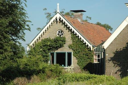 Farm in countryside near lake. - House