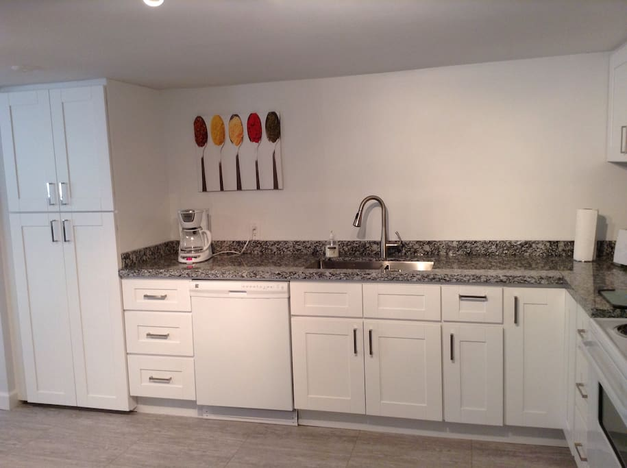 Double sink, dishwasher and pantry in the new kitchen