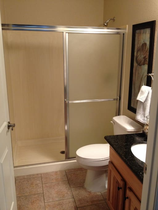 1st of 2 bathrooms with shower, and sink