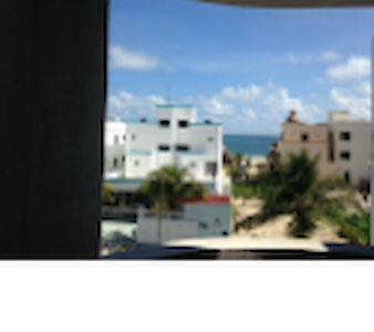Brand new apartment just half block of the most beautiful beach of Puerto Morelos. All the amenities, full kitchen. Ocean partial view and balcony. Three blocks from downtown and restaurants.