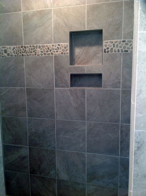 Newly tiled shower with spacious floor and walls