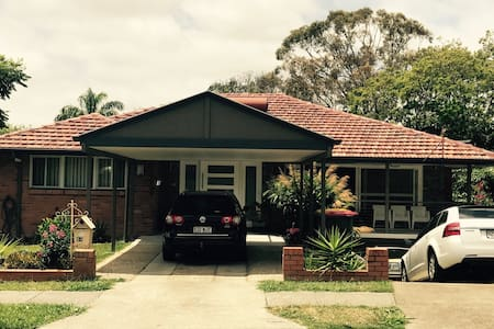 Light modern family home  with car - Aspley