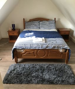 Blue loft room in mock tudor house - Potters bar