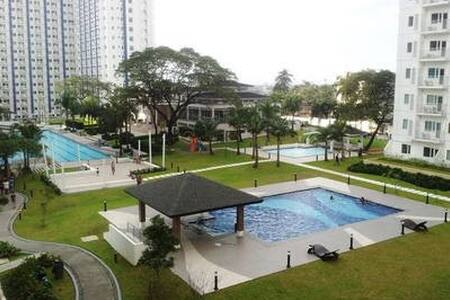 Cozy 1BR Condo Unit Near Mall with Amenities View - Quezon City