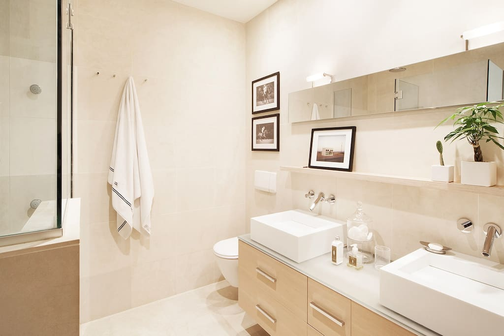 Spa-like bathroom with huge rain shower and premium finishes.