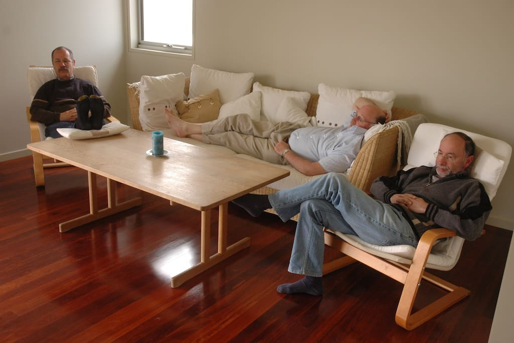 Relaxing after a hard day at the beach in comfortable armchairs and sofa.