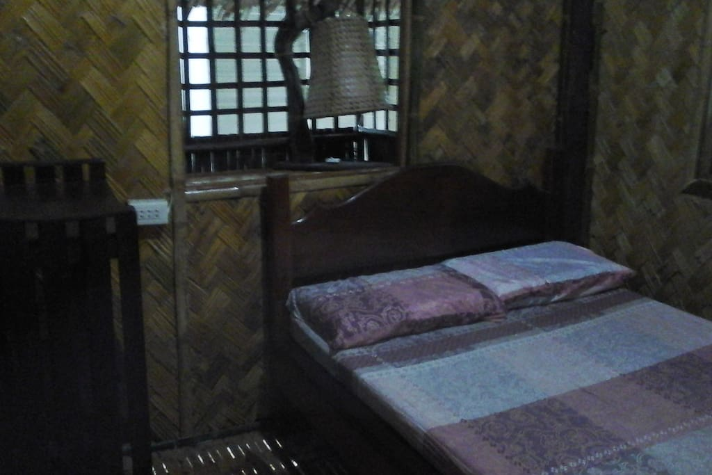 Double bedroom inside the nipa hut