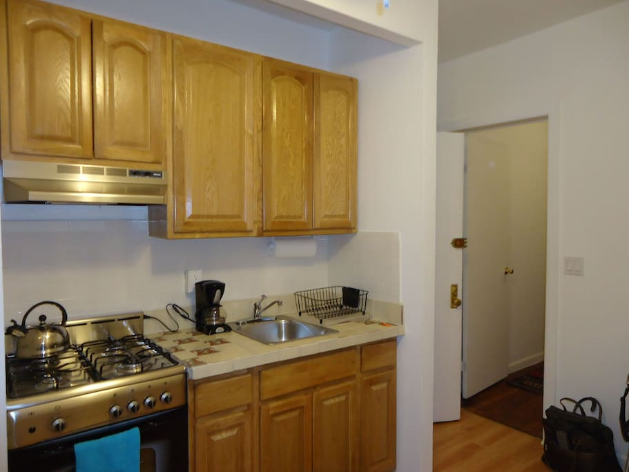 New gas range and refrigerator, Mexican tile counter