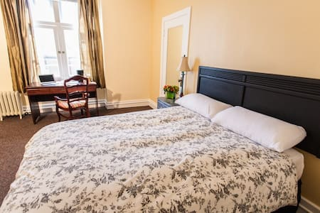 Private Queen rooms with private bathroom. We encourage you to book directly for a reduced rate. Call the Front Desk Sun-Thur 9am-5pm, Fri & Sat 9am-10:00pm to make a direct reservation.