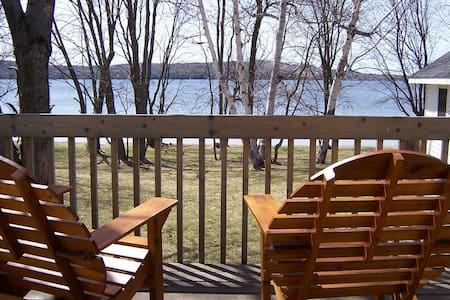 This cottage is 460 sq. ft. and is 150 ft. from the water's edge.  It has a queen bed, sofa bed, wood burning fireplace, TV, small fridge, microwave.  The bathroom has a 2 person air jacuzzi tub, and shower.   Pets allowed.