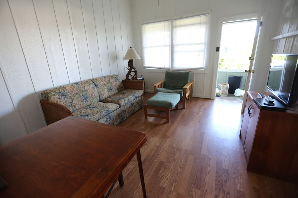 Wood floors and open floor plan in the living room..plenty of space to sit and relax!