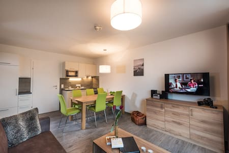 "The newly built holiday flats from ""Apartment Central Zell am See"", with the perfect location in the heart of the town, unite urban life style with clear design in combination with alpine tradition."