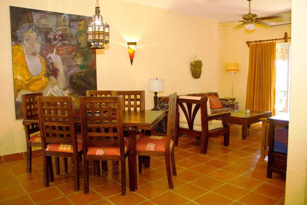 open dining area with big dining table which easily seats 6
