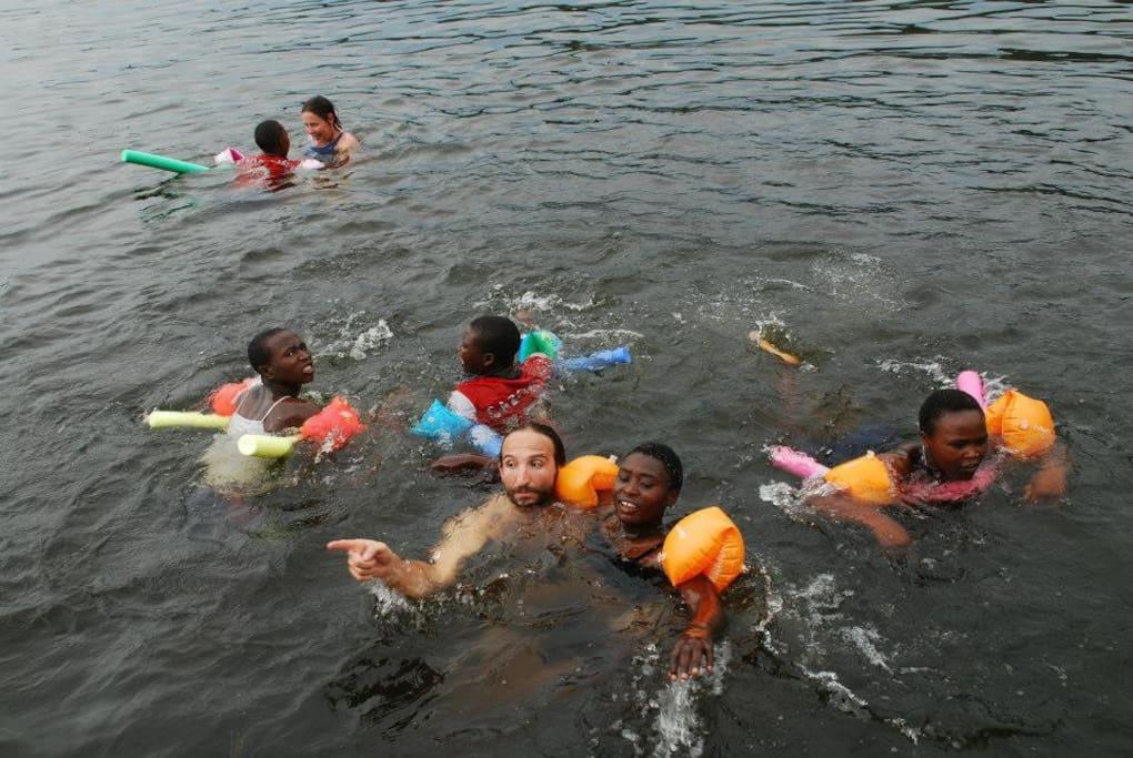 Swimming into Lake Mutanda, just 5 min walking from home.