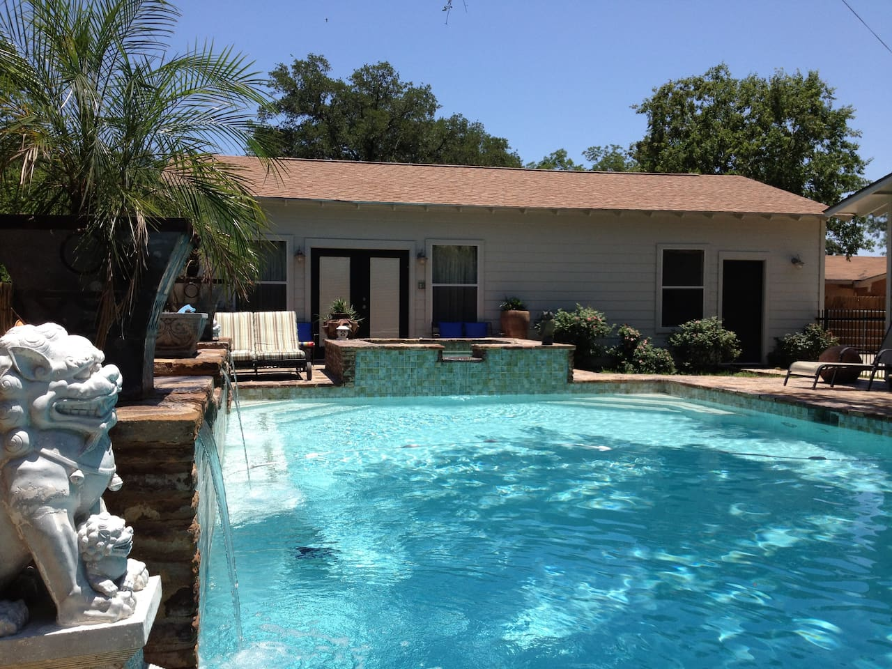 Shangri Loyd is a custom cabana tucked in a lush and private setting in the heart of Burnet. Sleep to the peaceful sounds of pool waterfalls and enjoy the view through picture windows and french patio doors.