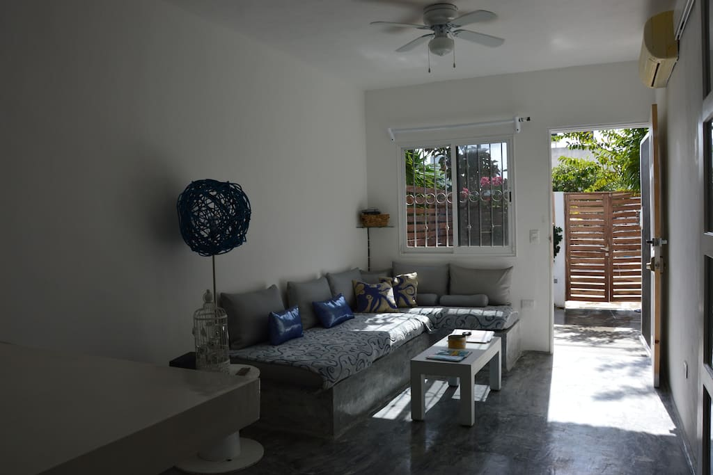 View of the living room from eat in kitchen area.
