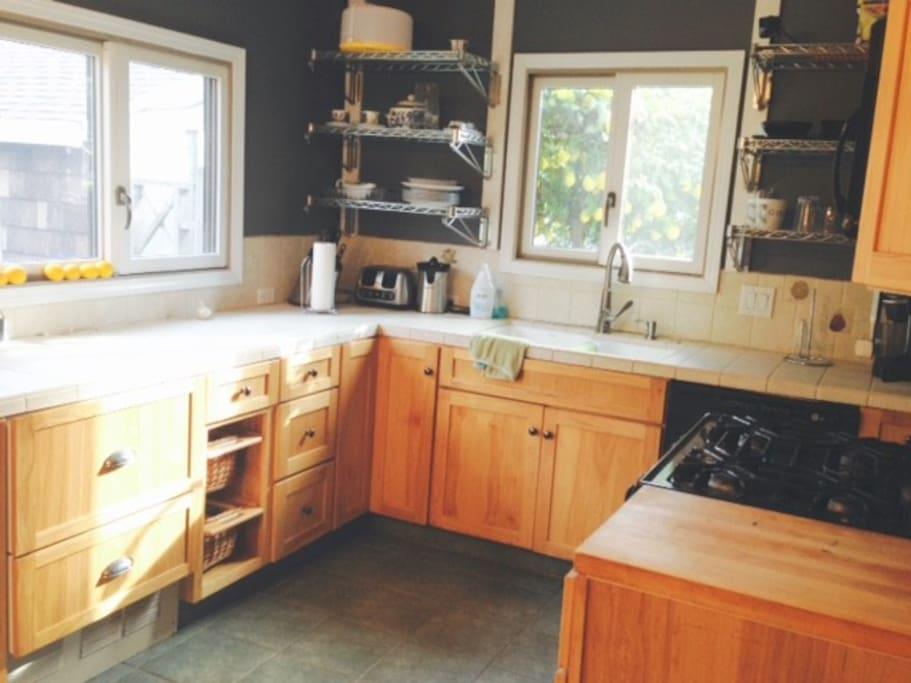Napa kitchen boasts views of lemon tree outside the sink window.  Help yourself to a couple lemons.