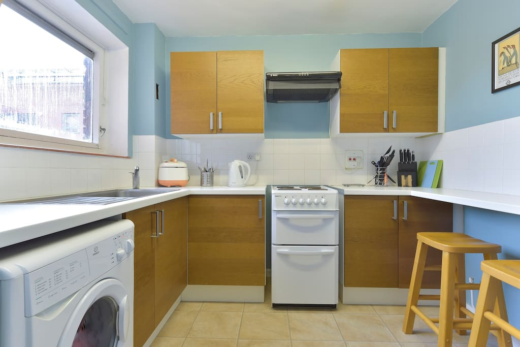 The kitchen comes with an oven and stove, washing machine, kettle, cutlery, crockery, tea towels, utensils, etc.