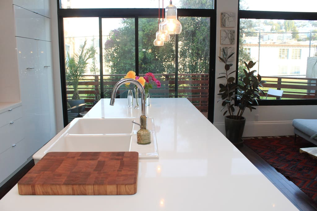 Kitchen island; deck, and view to elaborately ornamented, Mediterranean Revival/Baroque-style Mission High School