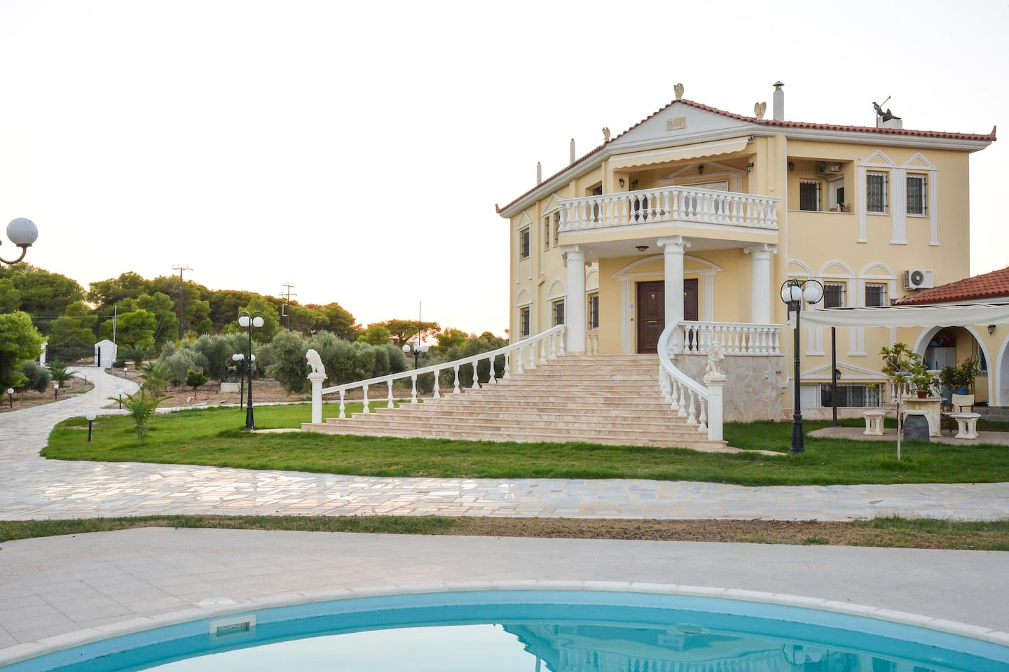 From the pool, looking towards the Villa and the marble path ending up to the main gates