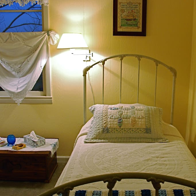 """""""The Kid's Room"""" has two wrought iron twin beds."""