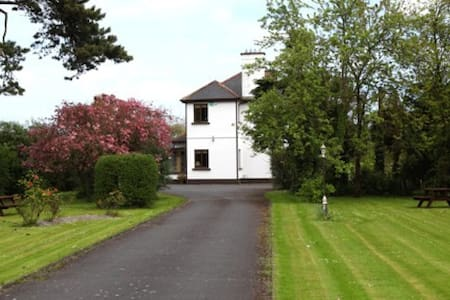 This beautiful and historic home is a former Ministers house set on 2 acres of wonderful landscaped gardens.  It is ideally located just a short stroll to the centre of Dungarvan town. Our bedrooms are spacious and comfortable with ensuite bathroooms