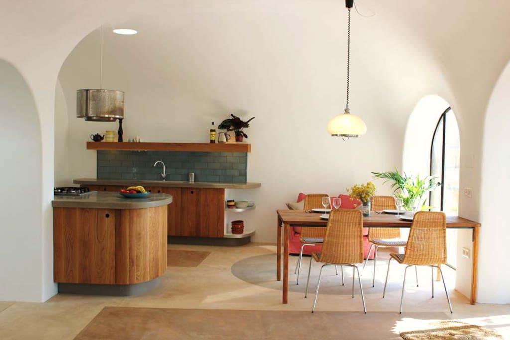 Bespoke concrete countertops in the oak panelled kitchen.
