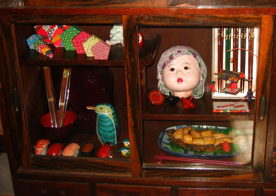 A curio cabinet with Japanese items adds to the living room decor.