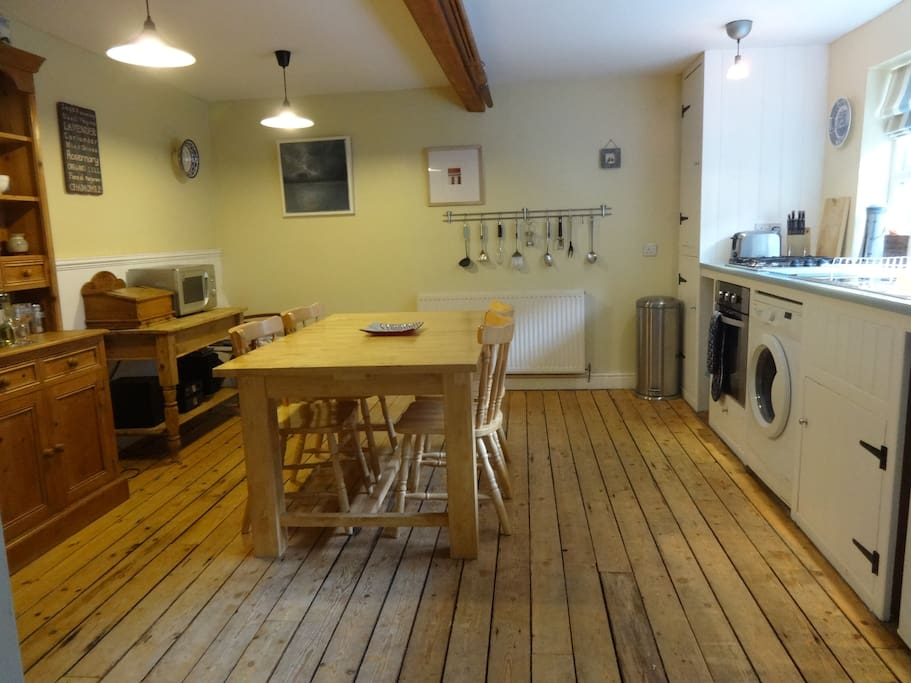 Well equipped cottage kitchen leading out to yard with outbuilding.
