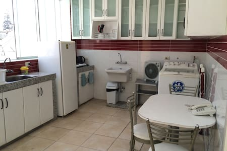 Mini apartment for rent on a 3rd floor with 2 rooms, one double and one single, each with its own bathroom (with hot water). The apartment is accessed from inside a house in Miraflores. It has its own kitchenette and dining table. Wifi included.