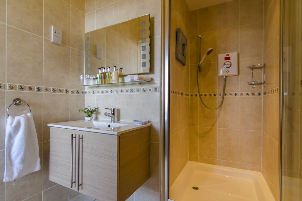 Roomy en-suite shower room with complimentary toiletries